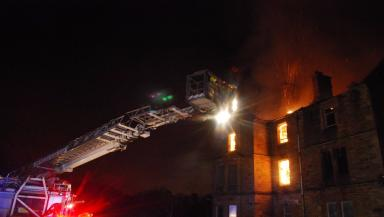 Battle: Fire crews used an aerial rescue pump to fight the blaze.