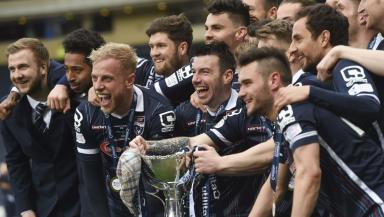 Celebrations: Ross County players get the party started at Hampden.