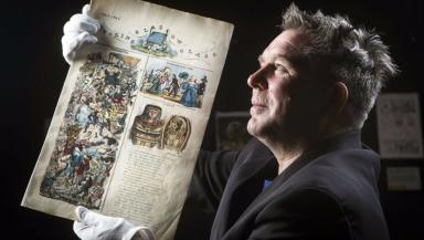 Glasgow comics: Curator Laurence Grove holds the worlds oldest comic.