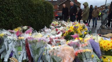 Tributes: Flowers laid outside shop in Shawlands.