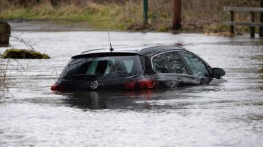 Water: Cars were left submerged earlier this week.