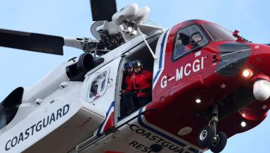 Rescue: Woman was flown to hospital but later died.