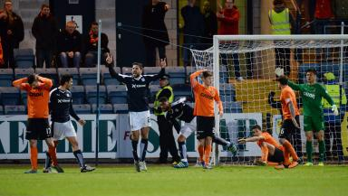 Dundee celebrate the equaliser which sent Dundee United down.