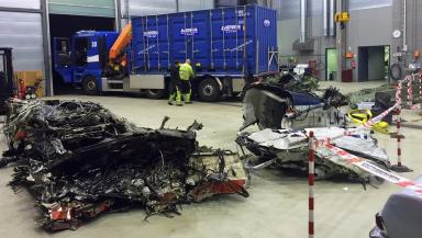 Wreckage: Investigators examine remains of helicopter.