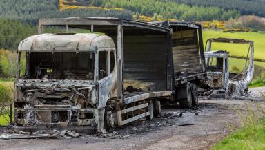 Torched: Lorries were taken and set alight in layby.