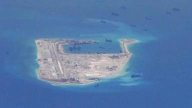 Chinese dredging vessels are purportedly seen in the waters around Fiery Cross Reef in the disputed Spratly Islands in the South China Sea