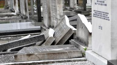 14 headstones were damaged by vandals