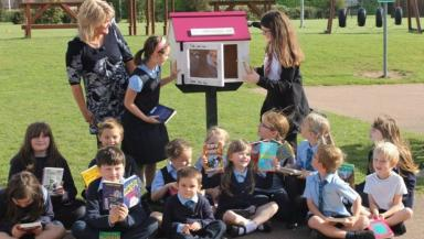 Swap shop: A group of pupils look after the school's outdoor library.