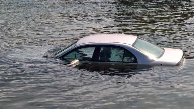Sinking: Car abandoned in water after harbour plunge.