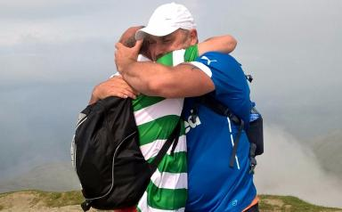 United in Grief: James and Craig embraced following their charity climb.