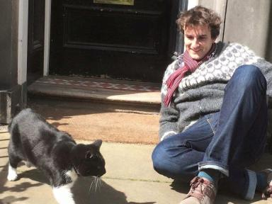 Alex Howard and Library Cat share a moment in the sunshine.