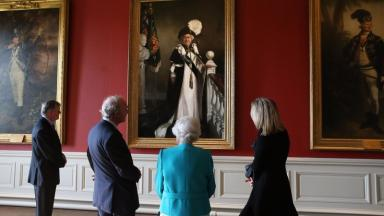 The Queen admires the new portrait.