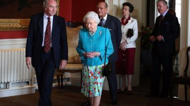 The Queen, the Duke of Edinburgh and Princess Anne at the unveiling of a new portrait of the Queen.
