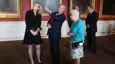 The Queen pictured the artist Nicky Philipps and the Duke of Buccleuch.
