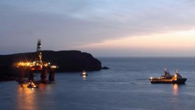 Dalmore Beach: Tugs being connected to rig on Monday.