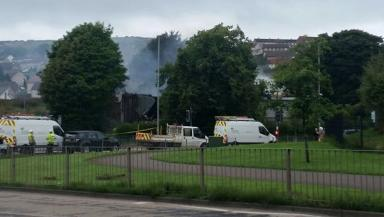 Destroyed: Emergency services attend fire at former masonic club.