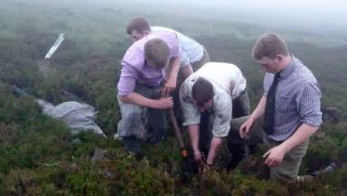 Rescue: Gamekeepers dig Jazz out of wet peat.