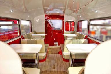 The bus has a retro bistro design.