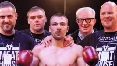 Winner: Mike Towell with team after victory in previous fight.