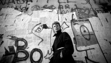 The Starman pictured beside the Berlin Wall