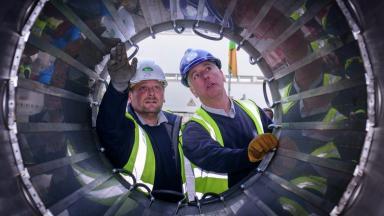 Super scanner: Workers inspect inside £10m MRI machine.