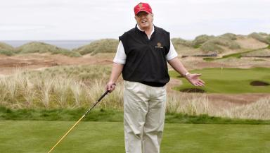 Donald Trump: US president playing a hole at his Aberdeenshire course.