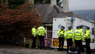 Inverkip: Police outside the property last year.