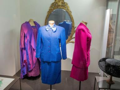 Three outfits and a hat worn by Baroness Thatcher are now on display in the V&A.