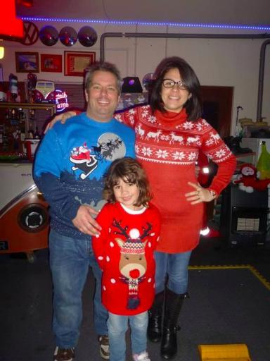 Tom Bruce, pictured with wife Patricia and daughter Melanie, loved Christmas.