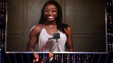 Simone Biles with her Overseas Personality of the Year award.