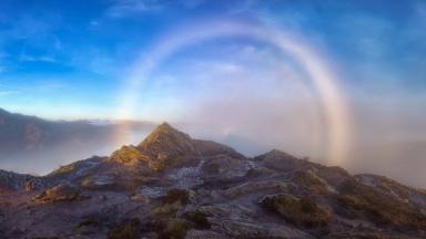 Rare glow: A Brocken Spectre rests under a fogbow arc.