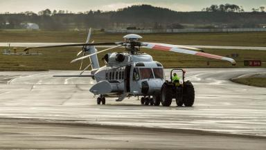 Aberdeen: S92 being towed off landing pad.