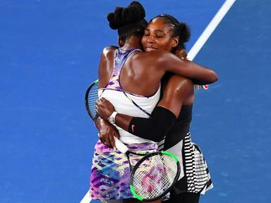 A heartfelt post-match hug at the net between the Williams sisters.