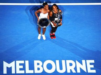 More silverware for Serena Williams (right) and sister Venus.