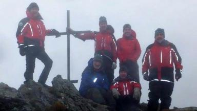 Killin MRT: Team members at Harry Lawrie memorial cairn.