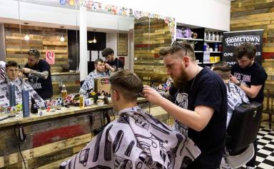 Big-hearted barbers: Mark and Roo support the local homeless community.