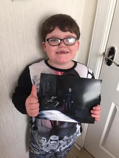 Aaron has received a photo autograph from Superman Henry Cavill.