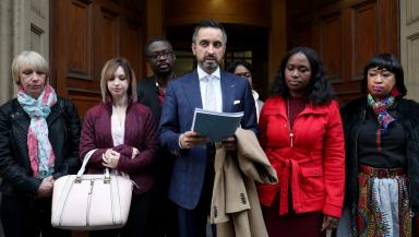 Meeting: Sheku Bayoh's relatives with solicitor Aamer Anwar outside the court.