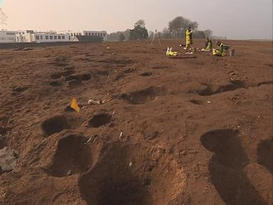 Pitch perfect: Archaeologists hail the discovery during works.