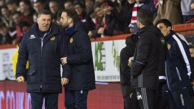 Touchline drama: James McFadden attempts to calm down Mark McGhee.
