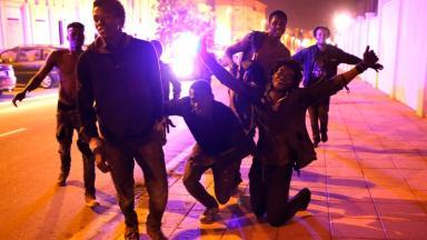 Migrants celebrate after entering Ceuta.