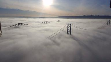 Forth Bridges: Electrician takes remarkable foggy snap.