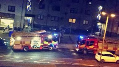 Blaze: Fire crews outside flat.