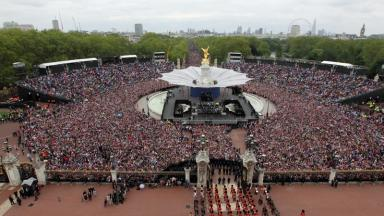 Crowds watch the Royal family from the Mall during the Diamond Jubilee celebrations in 2012