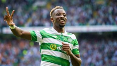 Moussa Dembele celebrates his hat-trick.