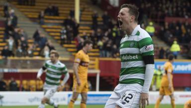 Callum McGregor celebrates at Fir Park.