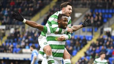 Moussa Dembele celebrates with Patrick Roberts after completing his hat-trick.