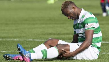 Not as bad as first feared: Moussa Dembele went down in Celtic's 2-1 win over Dundee.