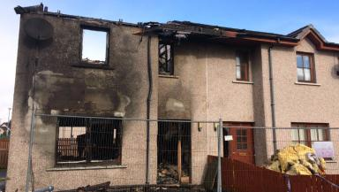 Gutted: The blaze burned out the Highland home.