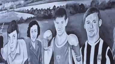 An image of Ryan McBride, right, features on a Derry City mural in Brandywell.